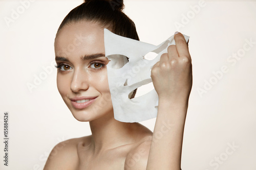 Fotografía  Woman Beauty Face. Young Female Removing Mask From Facial Skin
