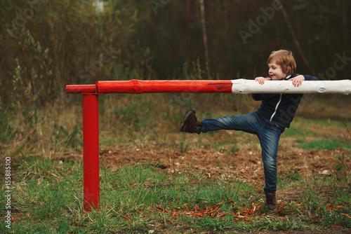 little playful boy with barrier Canvas Print