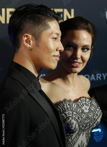 Cast Member Miyavi And Director Angelina Jolie Pose At The World