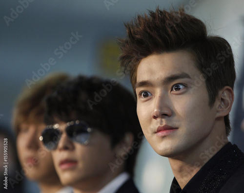 Siwon A Member Of South Korean Boy Band Super Junior Listens To A