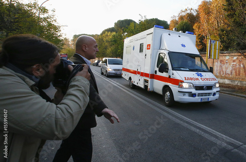 An ambulance carrying an Italian doctor, who contracted