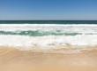 Waves breaking onto beach