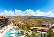 Beautiful view of the luxury hotel with golf courts hills and ocean on the Gran Canaria island.