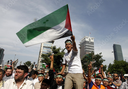 A demonstrator waves a Palestinian flag during a protest against