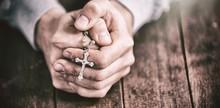 Man Praying With Rosary