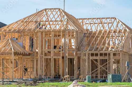 New stick built home under construction, blue sky in Texas, US ...