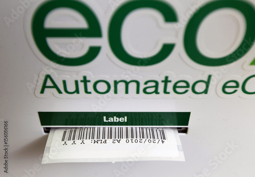 An ECO ATM machine prints out a barcode label for a used phone as