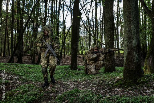 Camouflaged soldiers in forest - 156107122