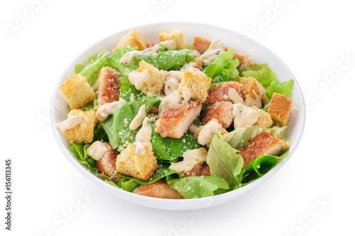 Fotografía  Caesar salad on white background.