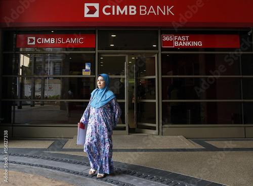 Woman leaves a CIMB bank branch in Putrajaya - Buy this