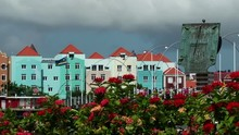 Flowers, Flag And A Sundial No The Waterfront Of Willemstad Curacao