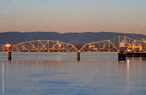 Deurstickers Bos rivier Railway swing bridge over Columbia River at sunrise