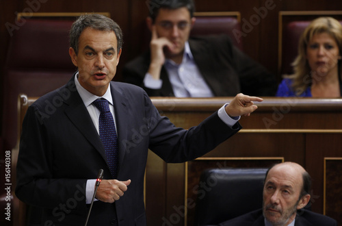 Spanish PM Zapatero answers a question during the weekly