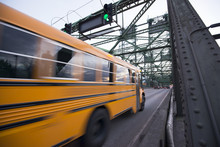School Bus Is Moving On Bridge With Green Traffic Light