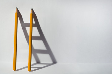 Two pencils and a shadow in...