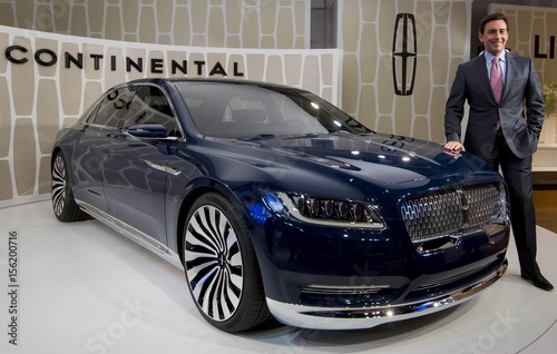 Ford Motor Co Ceo Fields Poses With The Lincoln Continental Concept