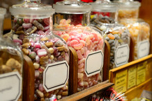 Filled Glass Candy Jars At The...