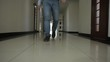 A young happy man goes to work in the office. The man in the corridor. Motorized slider.