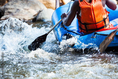 Close-up of young person rafting on the river, extreme and fun sport at tourist attraction
