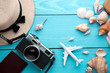 Summer holiday background, travel concept with camera on wooden table background