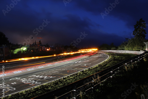 Photo sur Aluminium Motorise Racing car tail lights during the Nürburgring 24h race, long exposure at the Schwalbenschwanz bend