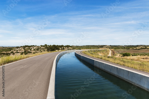 Poster Channel Curved Irrigation Canal in Farmland Landscape