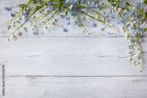 Wall Murals Lily of the valley Spring flowers of lilies of the valley, forget me not on a wooden background