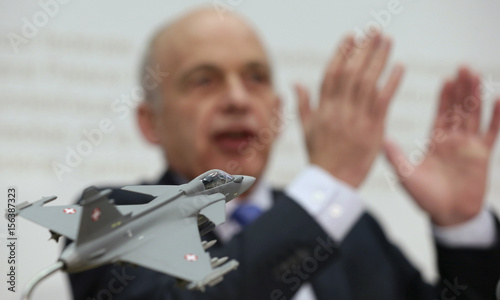 Swiss Defence Minister Maurer speaks to the media behind a