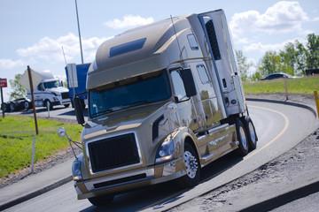 Modern semi truck reefer trailer on semicircular turn exit highway