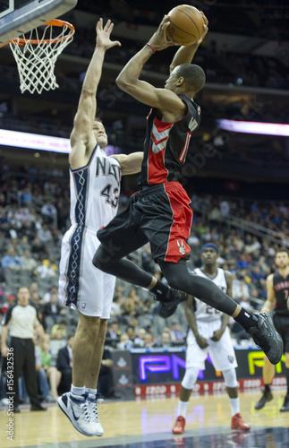 e1ad02632bc New Jersey Nets Kris Humphries blocks Toronto Raptors DeMar DeRozan in NBA  basketball game in Newark