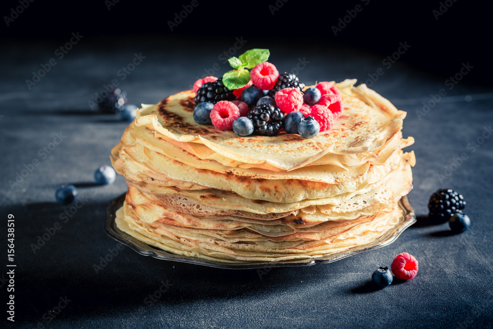 Fototapety, obrazy: Delicious stack of pancakes with blueberries and raspberries