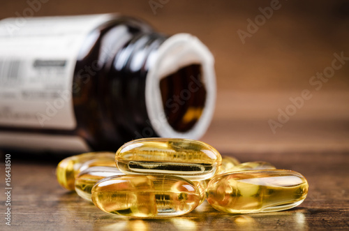 Valokuva  Fish oil capsules with omega 3 and vitamin D.