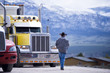 canvas print picture - Truck driver going to customized impressive yellow semi truck