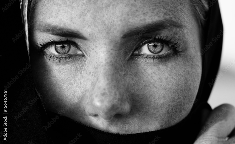 Fototapeta Woman face with deep eyes portrait, black and white photo session in the arabic style, monochrome, deep strong eyes