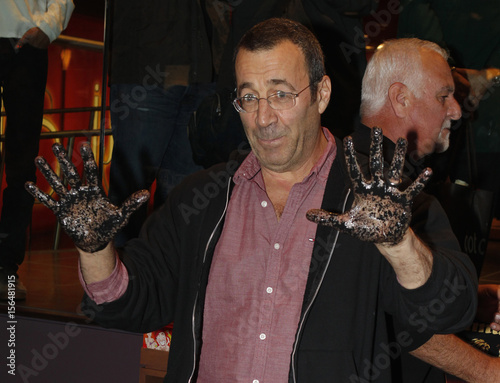 Adult Film Star And Producer John Stagliano Displays His Hands Covered With Cement During His Induction