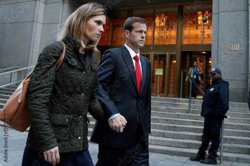 Andrew Caspersen and his wife Christina Caspersen depart