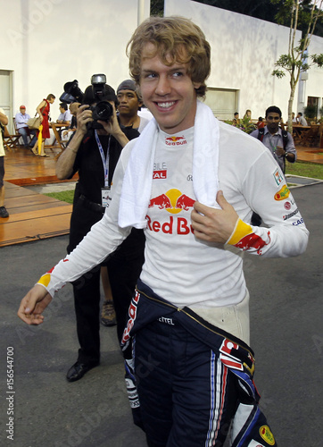 02d26d3f Red Bull Formula One driver Sebastian Vettel of Germany walks through the  paddock ahead of the