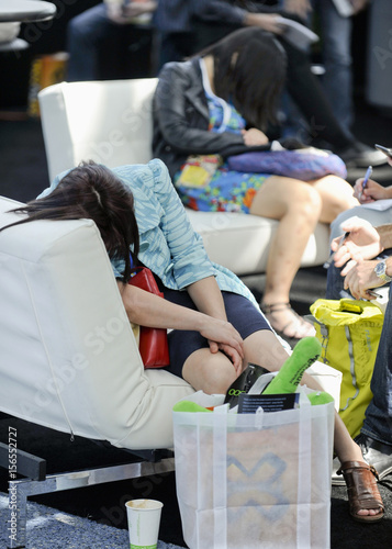Attendees sleep at the rest area during E3 in Los Angeles