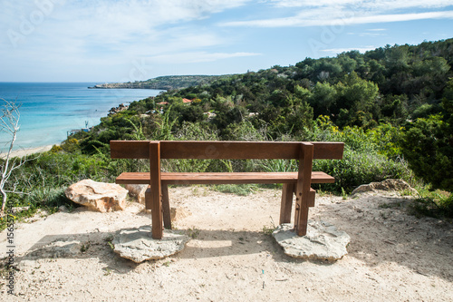 Foto op Plexiglas Cyprus Cyprus. Cape Greco National Forest Park . An empty bench for relaxing on the background of the sea and mountains