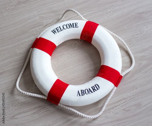 Fotografie, Obraz  red lifebuoy with welcome aboard text