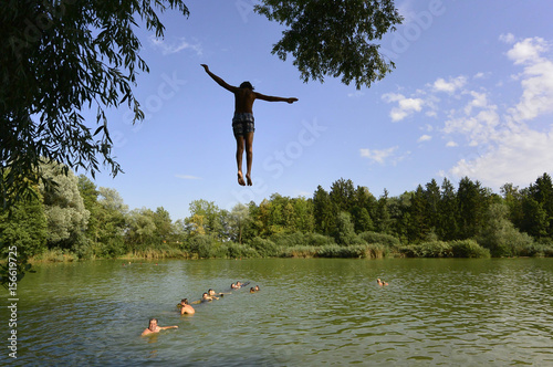 Boy Jumps From A Tree Into Pond Near Kranj As Temperatures Reached 41 Degrees