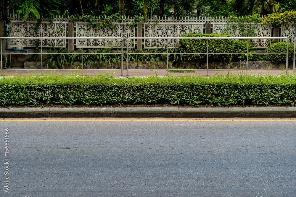Fototapeta Asphalt road with concrete curb