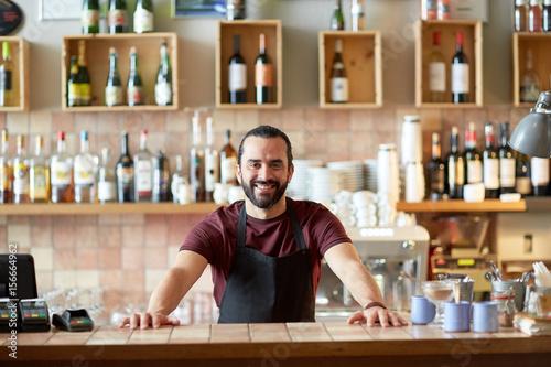 Obraz happy man, barman or waiter at bar - fototapety do salonu