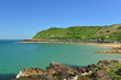 Giffard Bay, Jersey, U.K. Wide angle image of a coastline in the Summer with tropical teal seas.