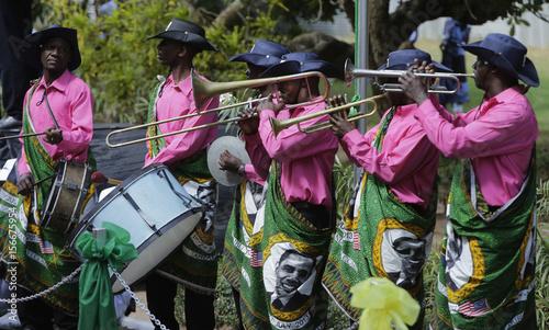Tanzanian musicians wearing the local kitenge dress, bearing the