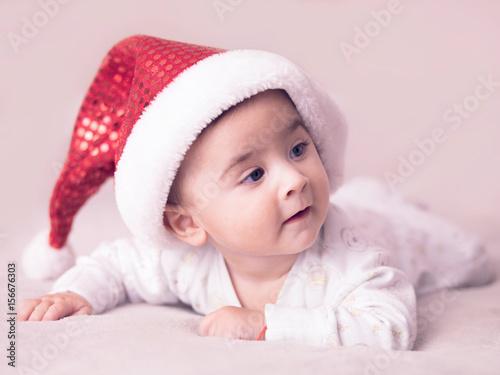Fotografie, Obraz  Portrait of baby boy wearing christmas hat.