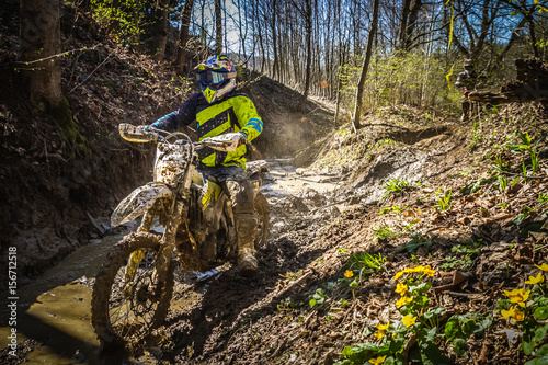 Motocross rider passes through the mud on the hardenduro race