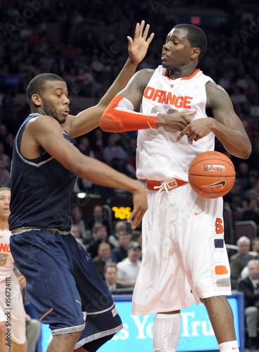 Syracuse University Forward Rick Jackson Has The Ball Stripped From