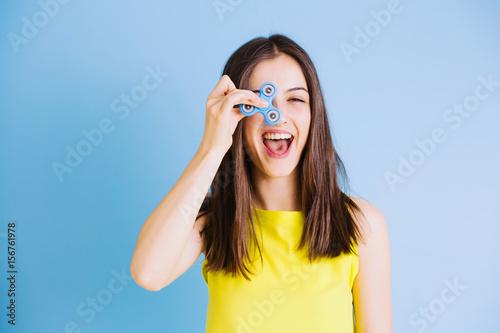 Fototapeta  Woman playing with fidget fingers