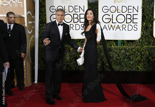 Actor George Clooney and his wife Amal Clooney arrive at the